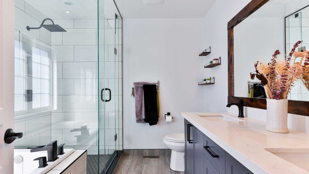 can a bathroom mirror be wider than the sink